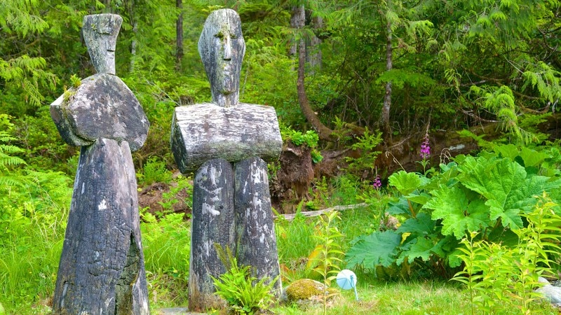 Tofino Botanical Gardens featuring a garden, outdoor art and a statue or sculpture