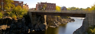 Skowhegan which includes a bridge and a river or creek