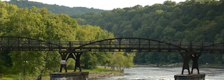Uniontown featuring a bridge and a river or creek