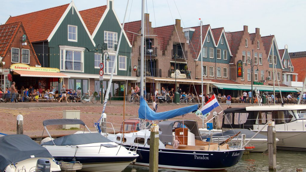 Volendam Harbour showing a bay or harbor, a coastal town and boating