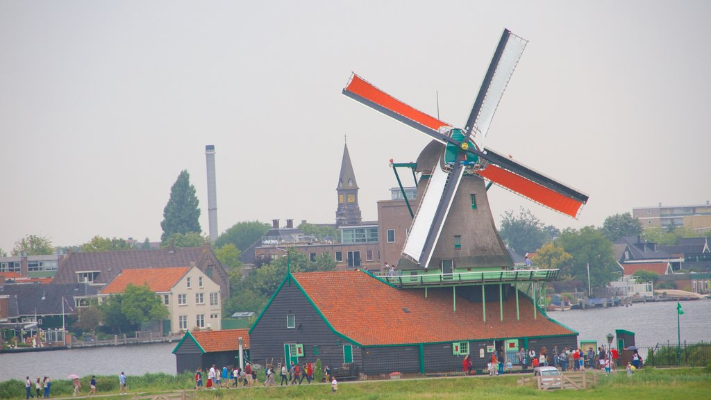 Zaanse Schans featuring general coastal views, a small town or village and a windmill