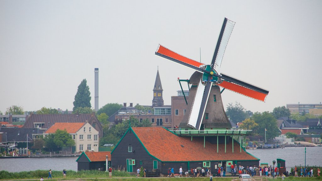 Zaanse Schans which includes a small town or village, general coastal views and a windmill