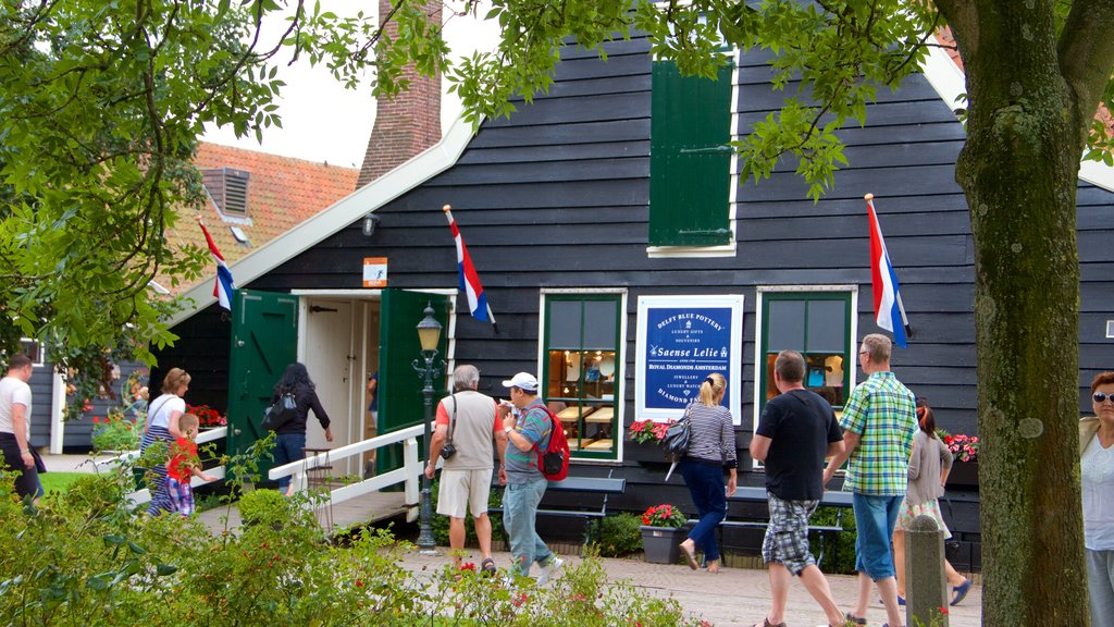 Zaanse Schans which includes shopping as well as a large group of people