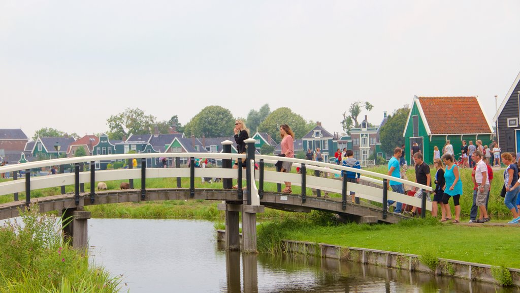 Zaanse Schans featuring a small town or village, a bridge and a lake or waterhole