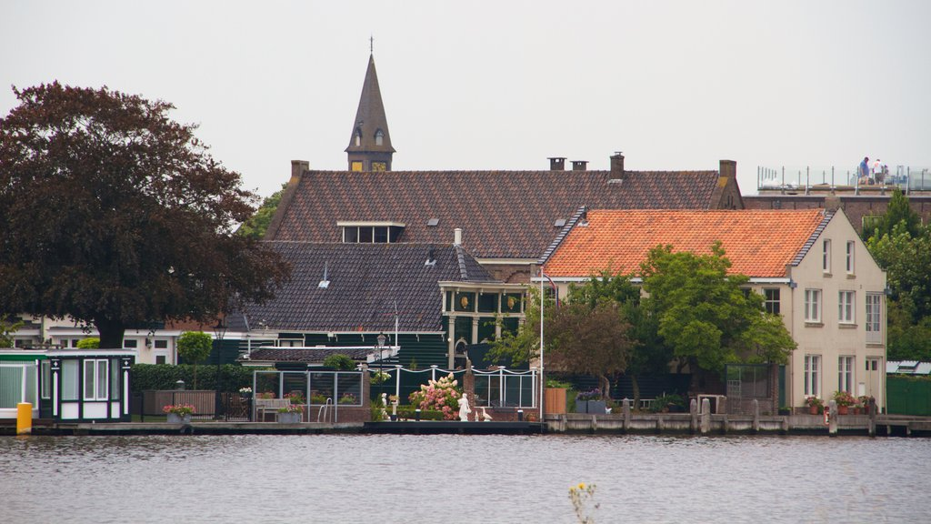 Zaanse Schans which includes a lake or waterhole and a city