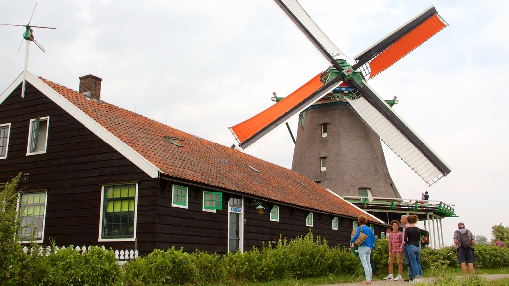 Zaanse Schans which includes a windmill as well as a family
