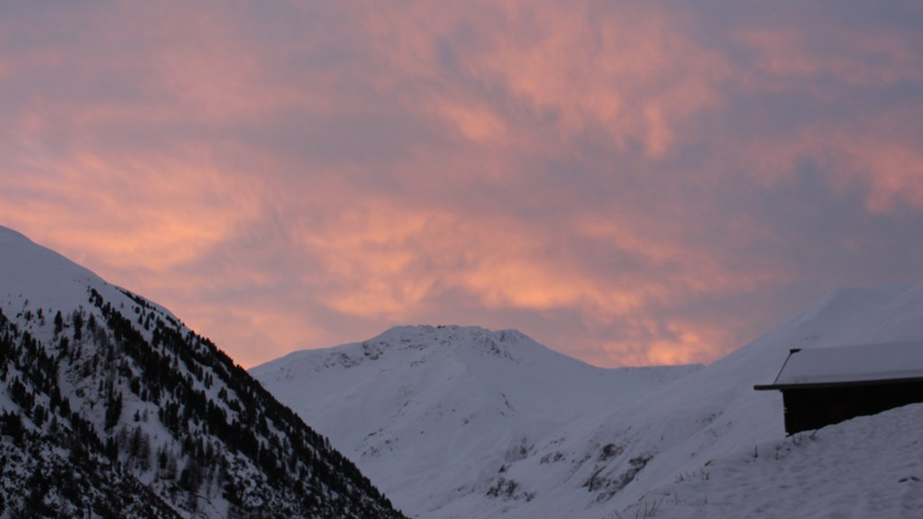 Livigno featuring snow, a sunset and mountains
