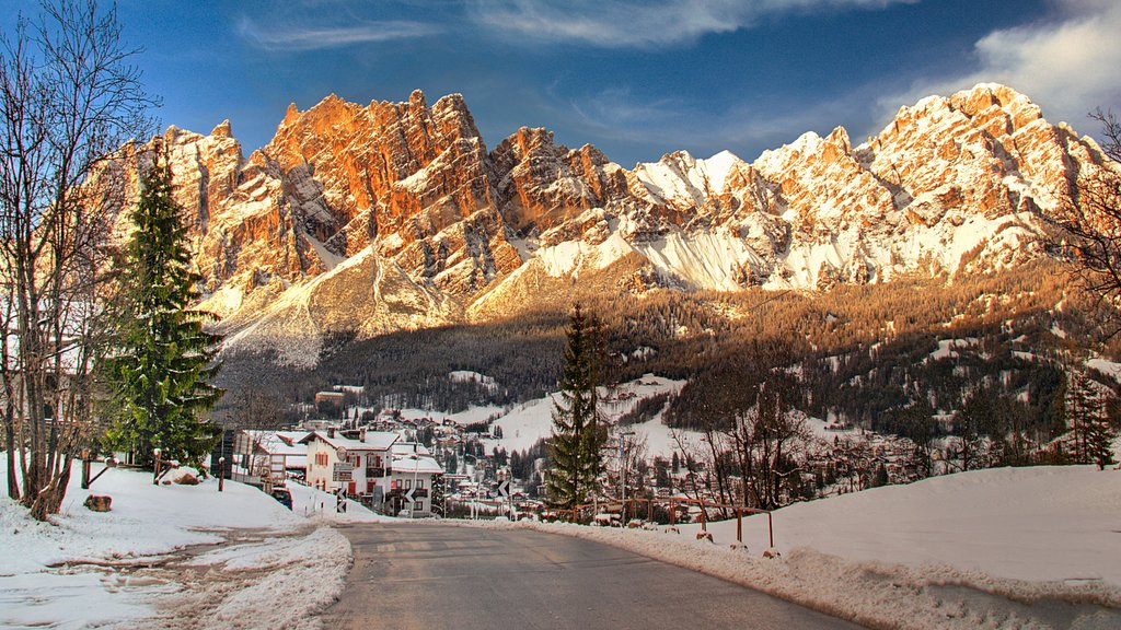 Cortina d\'Ampezzo featuring a small town or village, mountains and snow
