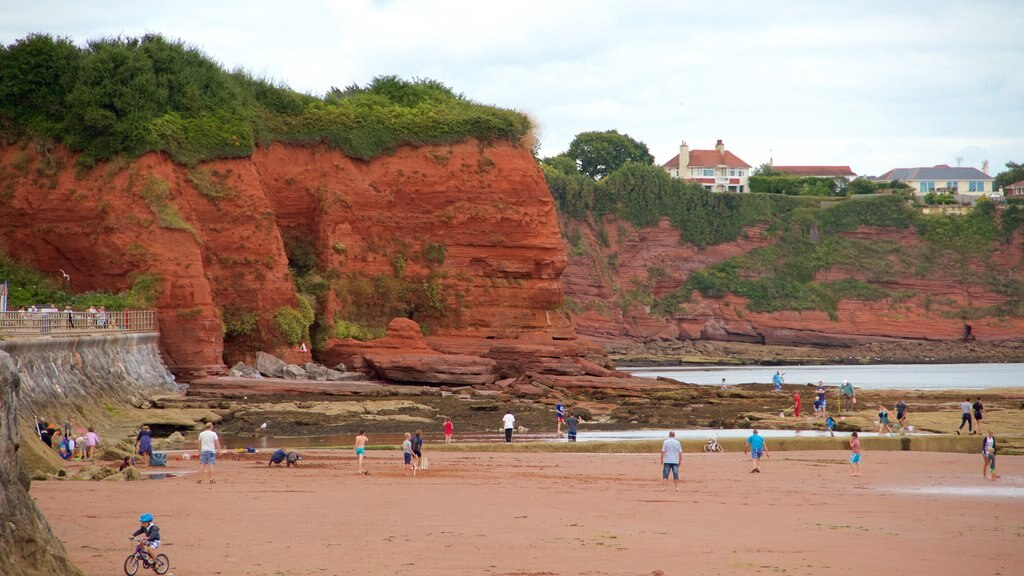 Torquay showing rocky coastline, a sandy beach and general coastal views