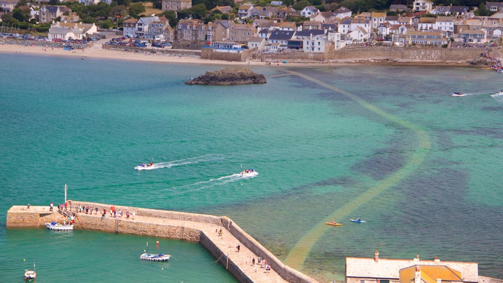 St. Michael\'s Mount showing a coastal town, a bay or harbor and boating