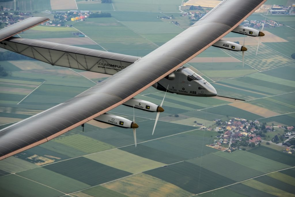 Zukunft des Reisens in Payerne, Switzerland: Today,<figcaption>Solar Impulse 2</figcaption>, the second single-seater solar aircraft of Bertrand Piccard and André Borschberg designed to take up the challenge of the first round-the-world solar flight, without any fuel in 2015, carried out its first flight out of the Payerne aerodrome in Switzerland. There will be several other test flights taking place in the coming months in order for this experimental machine to attain certification. They will be followed by training flights of Bertrand Piccard and André Borschberg later in the season still from Payerne airfield. The attempt to make the first round-the-world solar-powered flight is scheduled to start in March 2015 from Gulf area. Solar Impulse will fly, in order, over the Arabian Sea, India, Burma, China, the Pacific Ocean, the United States, the Atlantic Ocean and Southern Europe or Northern Africa before closing the loop by