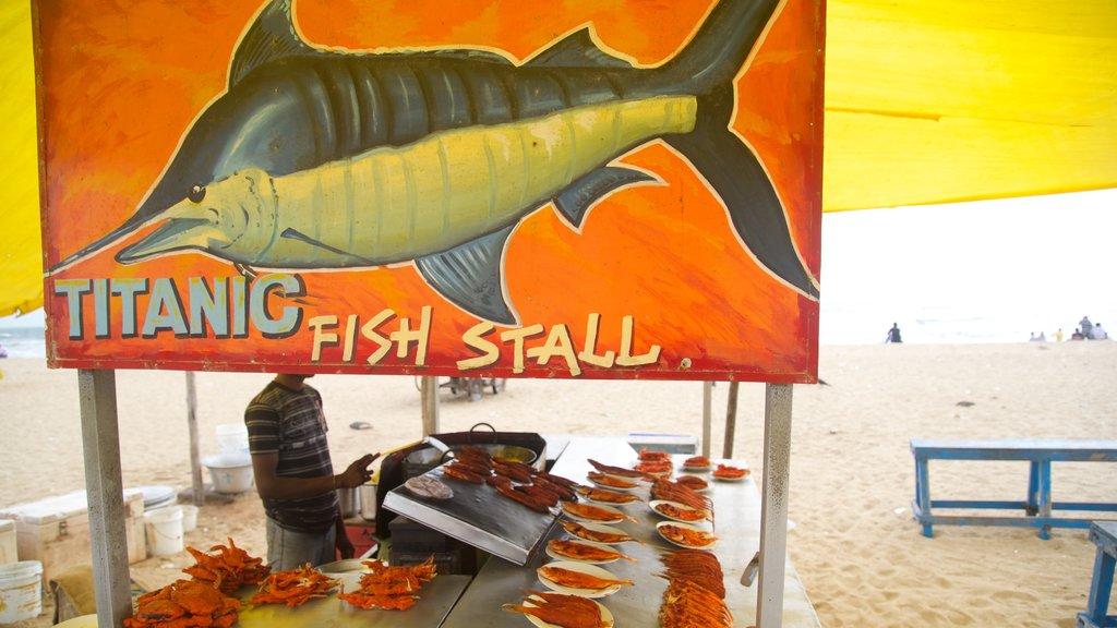 Marina Beach featuring food and signage