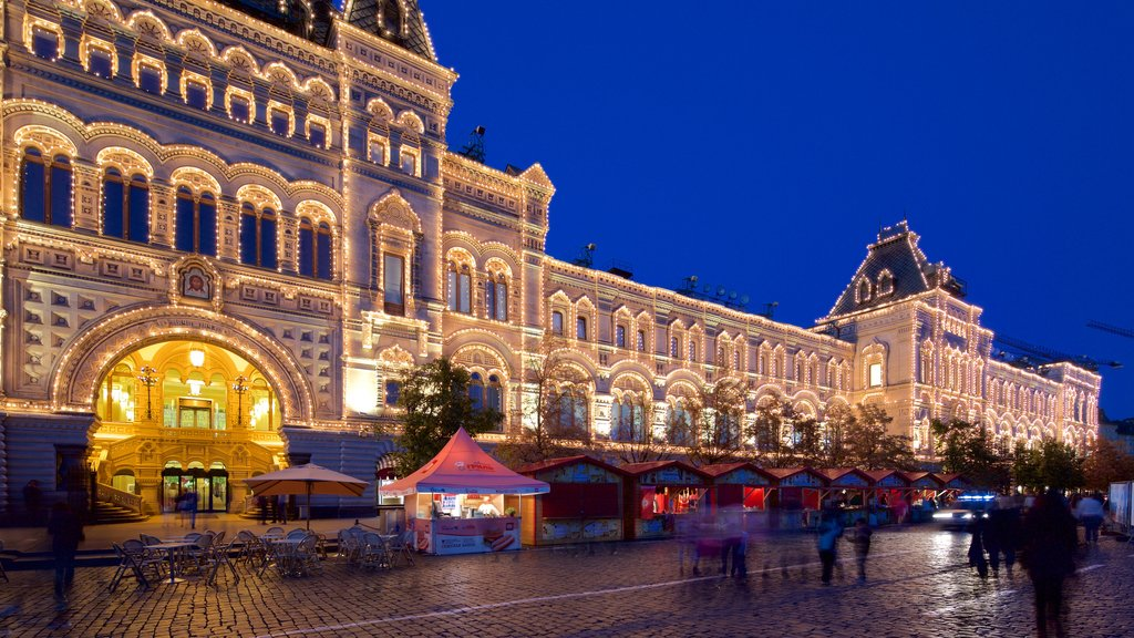 Kremlin which includes an administrative buidling, night scenes and heritage architecture
