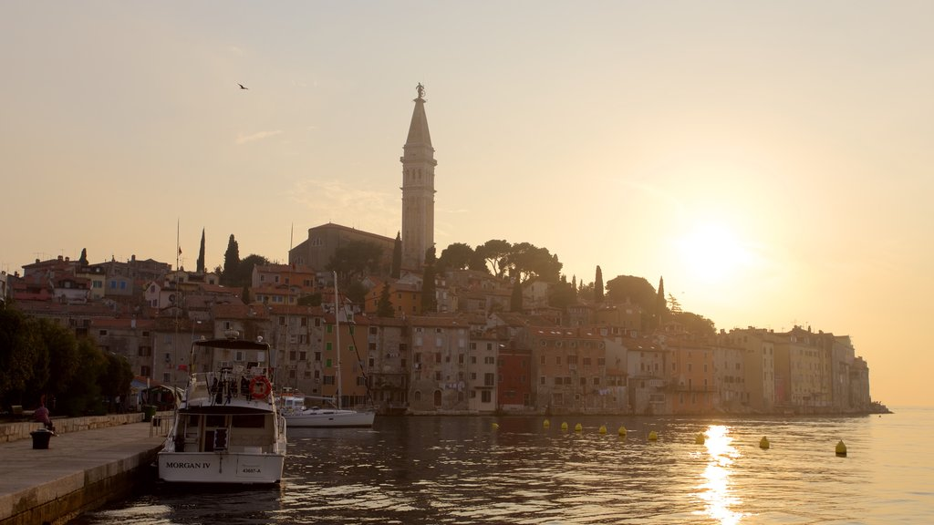 Rovinj Harbour showing a sunset, a city and general coastal views