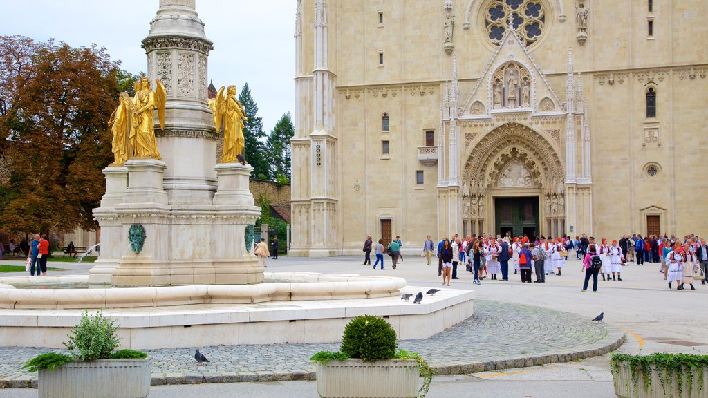 Zagreb Cathedral which includes a statue or sculpture and a church or cathedral