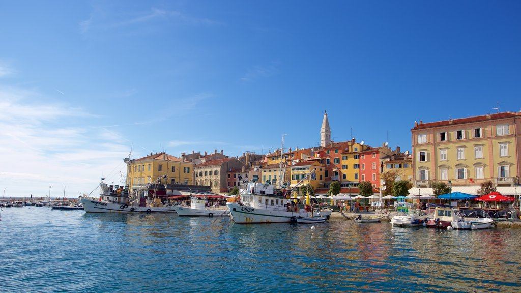 Rovinj Harbour featuring a bay or harbor, boating and a coastal town