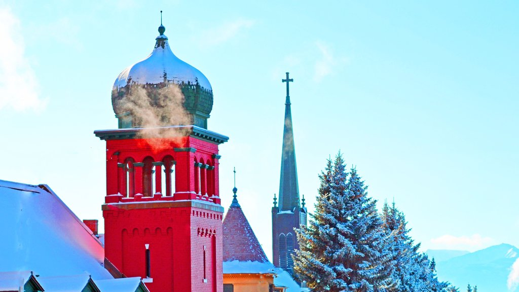 Butte which includes snow, religious elements and heritage architecture