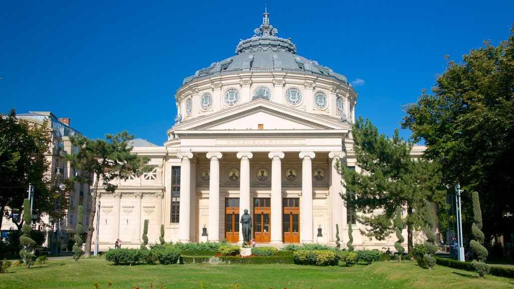 Romanian Athenaeum featuring a garden, a square or plaza and a statue or sculpture