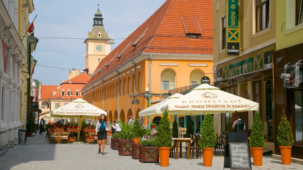 Brasov featuring a city and cafe scenes as well as an individual femail