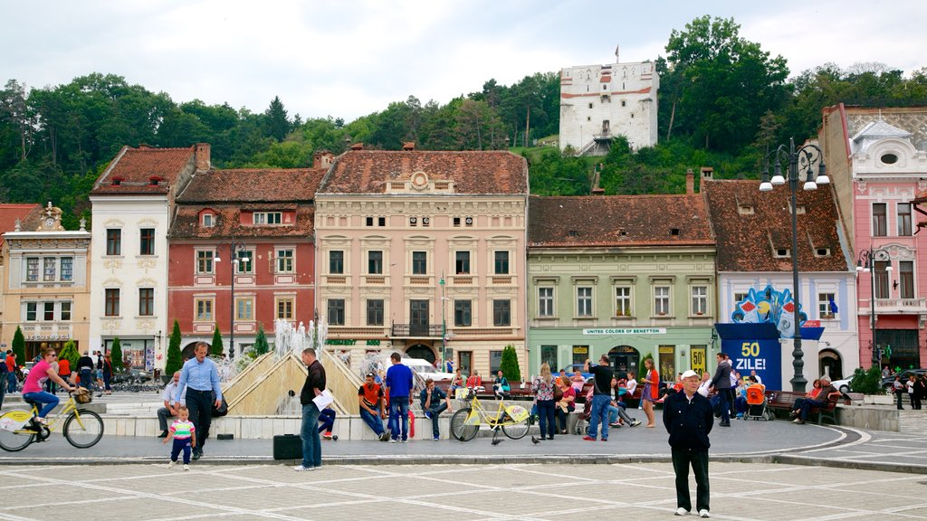 Brasov showing a square or plaza and a city as well as a large group of people