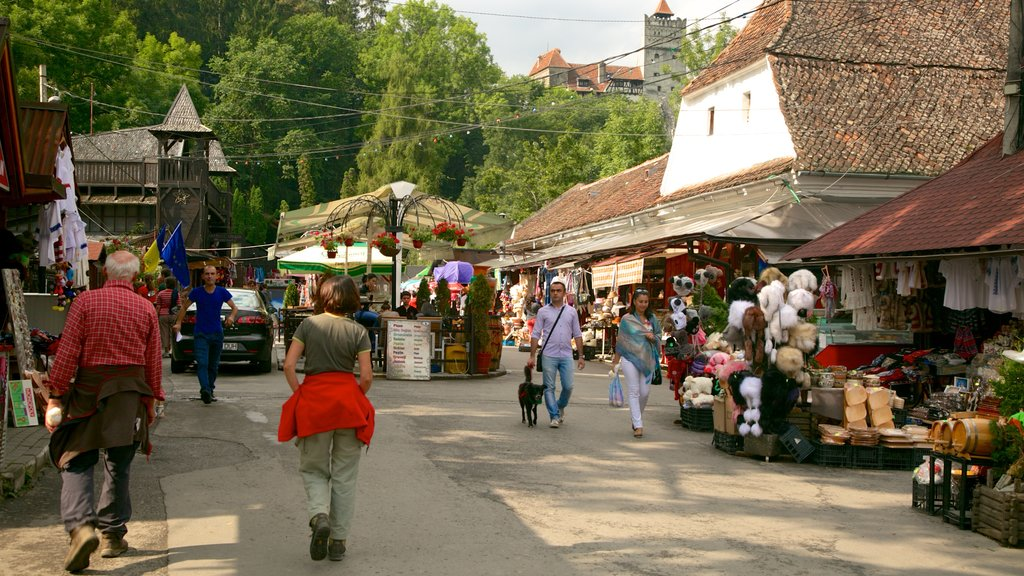 Bran Castle featuring street scenes, a small town or village and markets