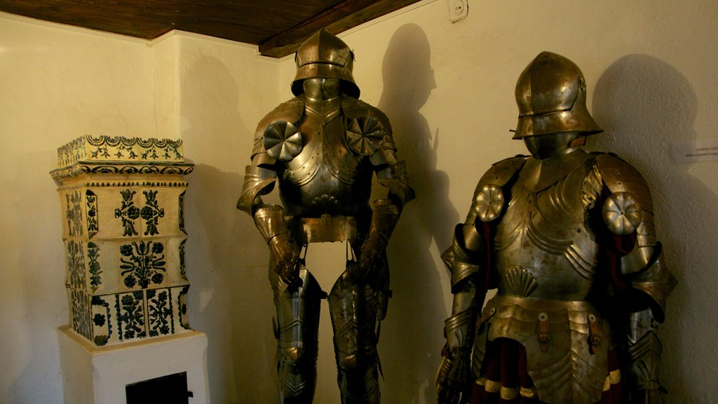 Bran Castle which includes interior views, military items and chateau or palace
