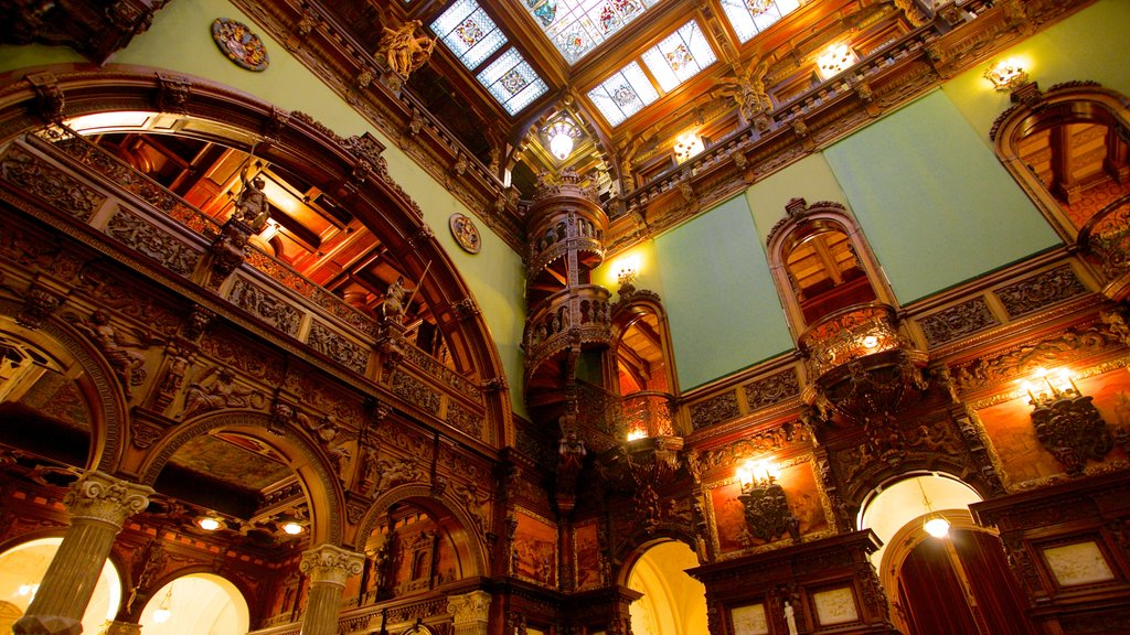 Peles Castle featuring chateau or palace, interior views and heritage architecture