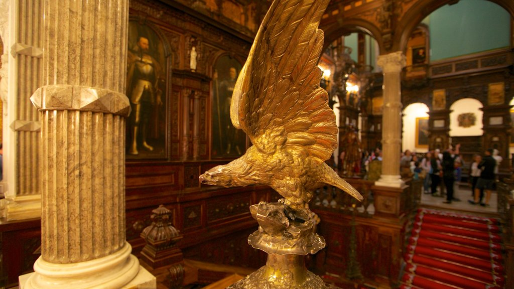 Peles Castle featuring heritage architecture, interior views and a statue or sculpture