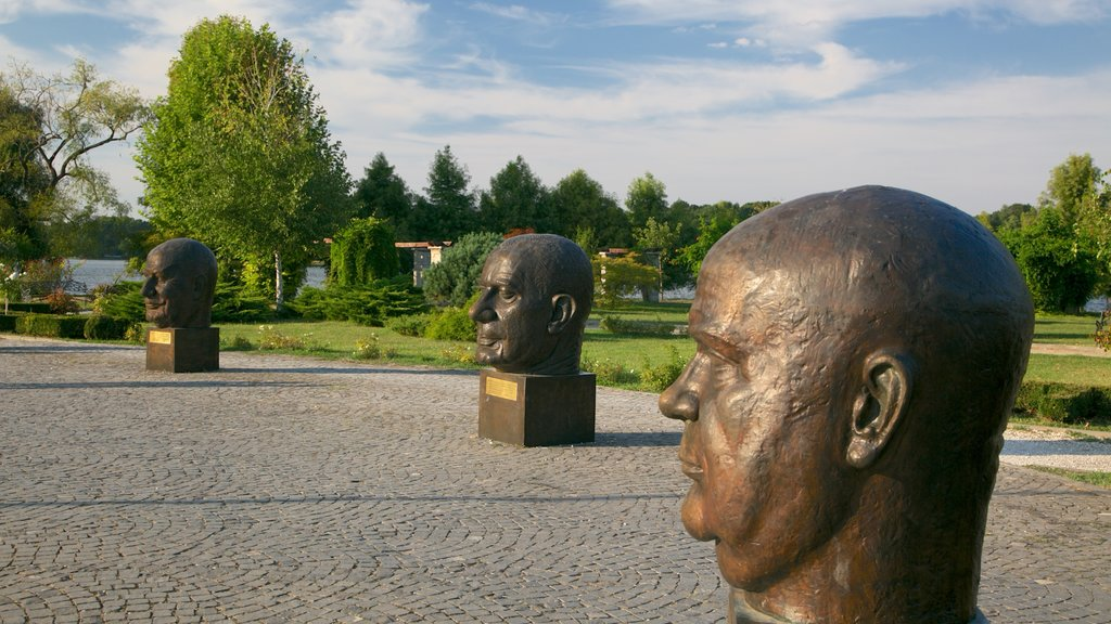 Herastrau Park featuring a statue or sculpture and a park