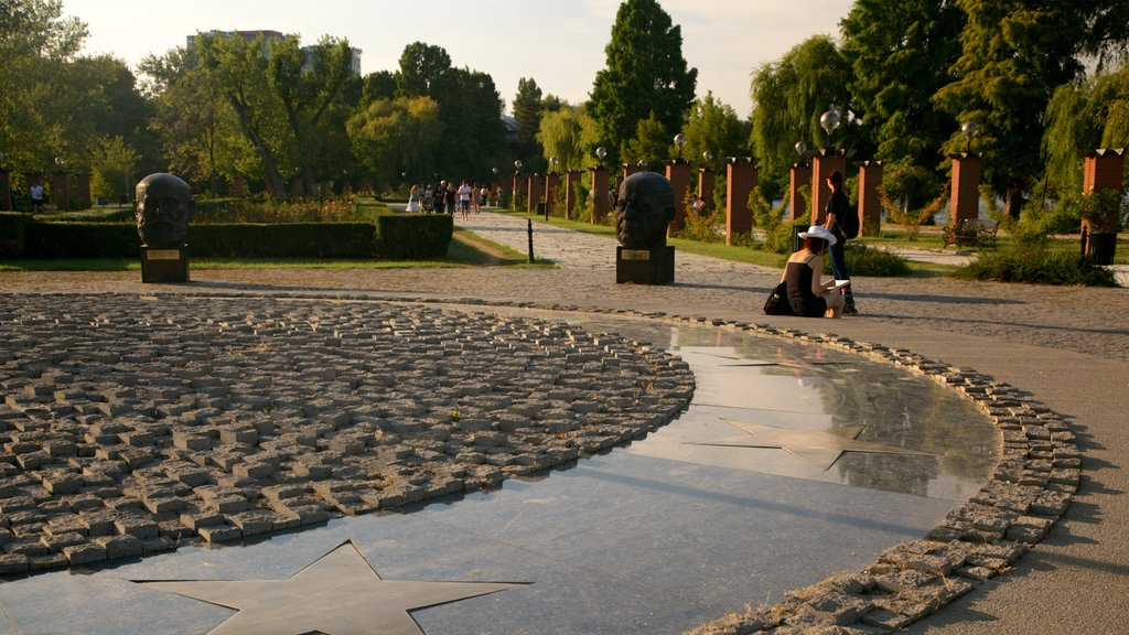Herastrau Park featuring a park, a statue or sculpture and a fountain