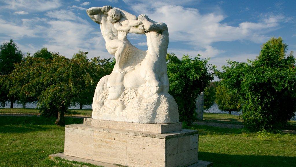 Herastrau Park featuring outdoor art, a garden and a statue or sculpture