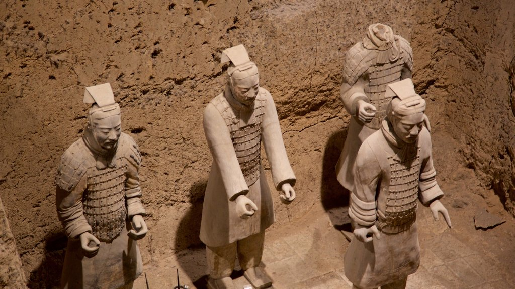 Terracota Army featuring interior views and a statue or sculpture