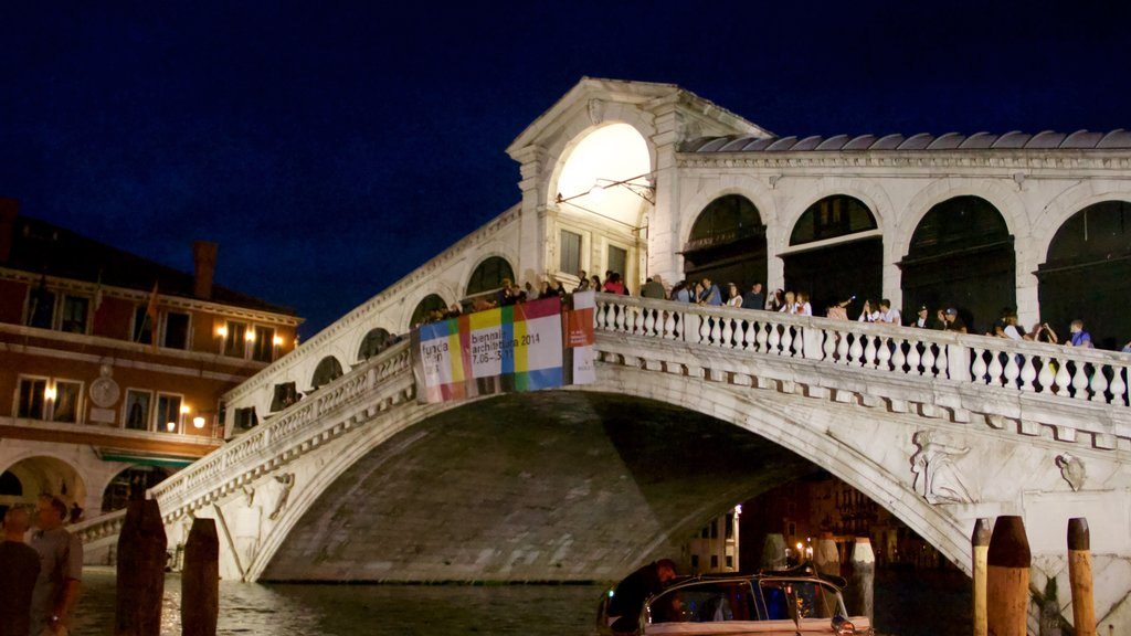 Venice featuring a bridge, night scenes and a river or creek
