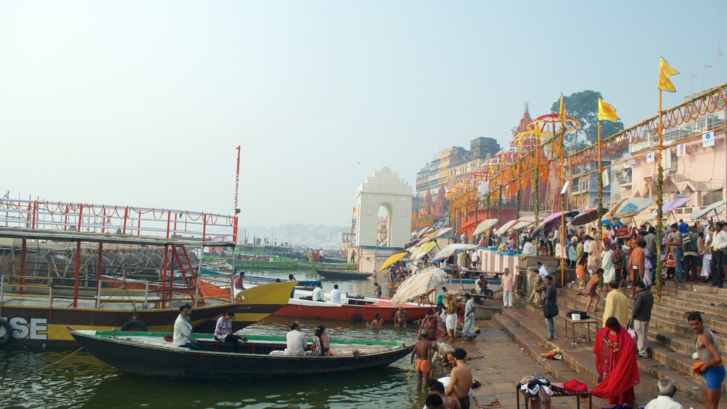 Dasaswamedh ghat showing markets and a bay or harbor as well as a large group of people