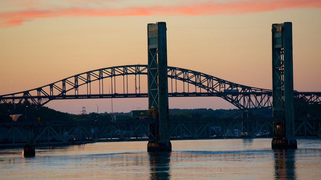 Portsmouth showing a bridge, a sunset and a river or creek