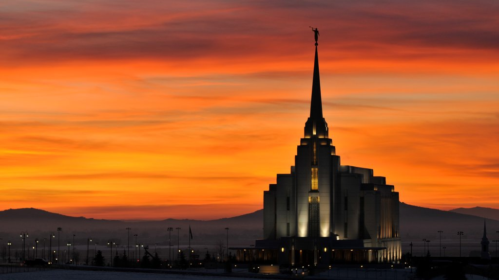 Rexburg featuring a church or cathedral and a sunset