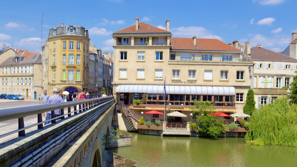 Metz which includes a house, a river or creek and a bridge