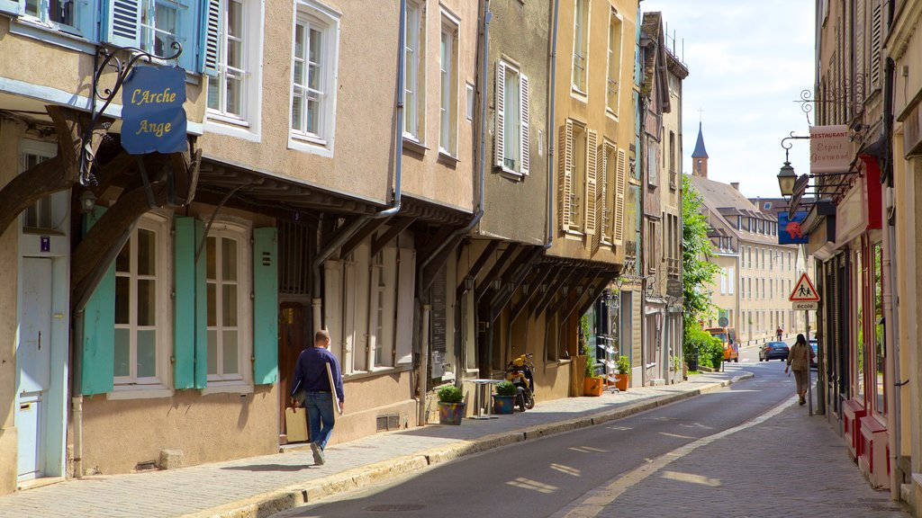 Chartres featuring street scenes as well as an individual male