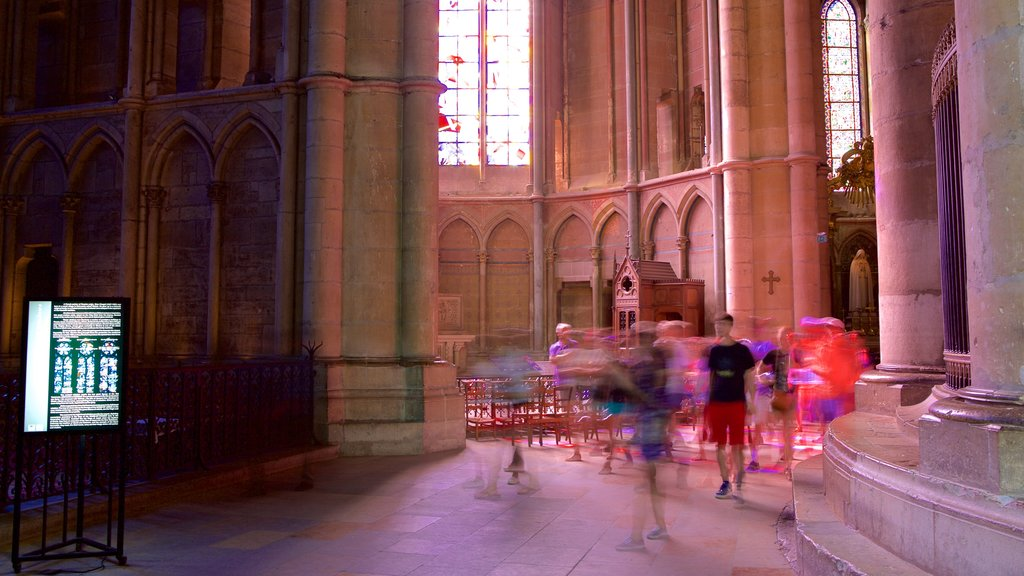 Reims Cathedral which includes heritage elements, interior views and a church or cathedral