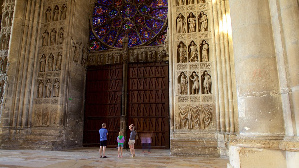Reims Cathedral featuring a church or cathedral and interior views as well as a family