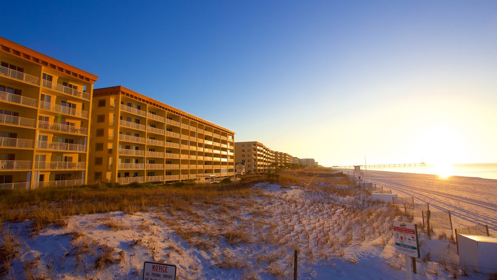 Fort Walton Beach showing a sandy beach, a hotel and a sunset