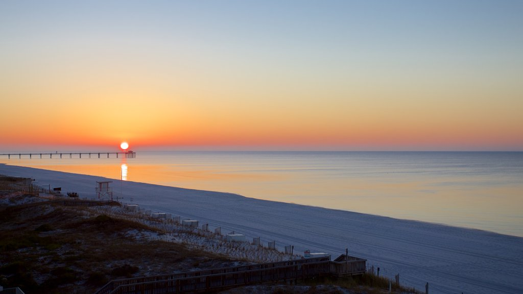 Okaloosa Island which includes a sunset and general coastal views