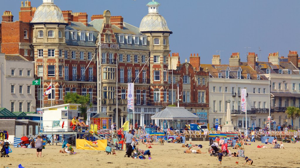 Weymouth Beach showing a beach as well as a large group of people