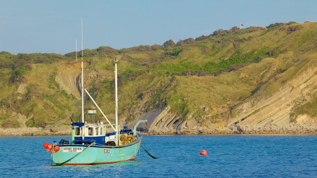 Lulworth Cove Beach featuring rugged coastline and boating