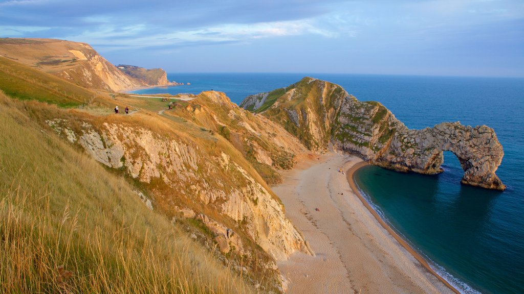 Durdle Door featuring general coastal views, rugged coastline and tranquil scenes
