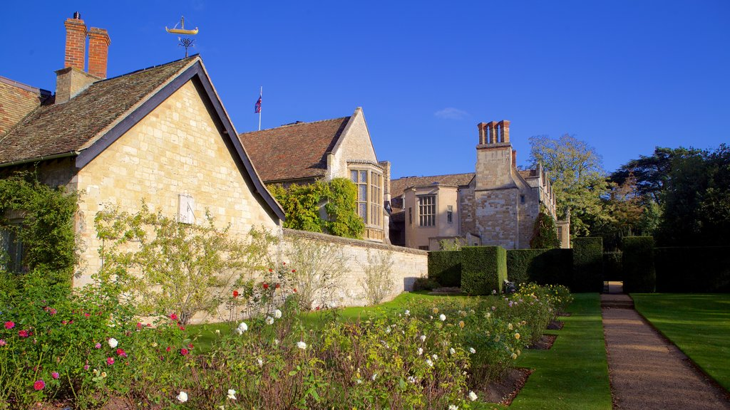 Anglesey Abbey featuring flowers, heritage elements and a park