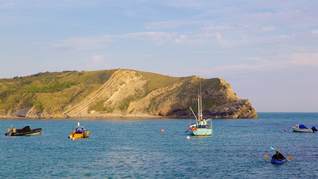 Lulworth Cove Beach featuring boating, a bay or harbor and kayaking or canoeing