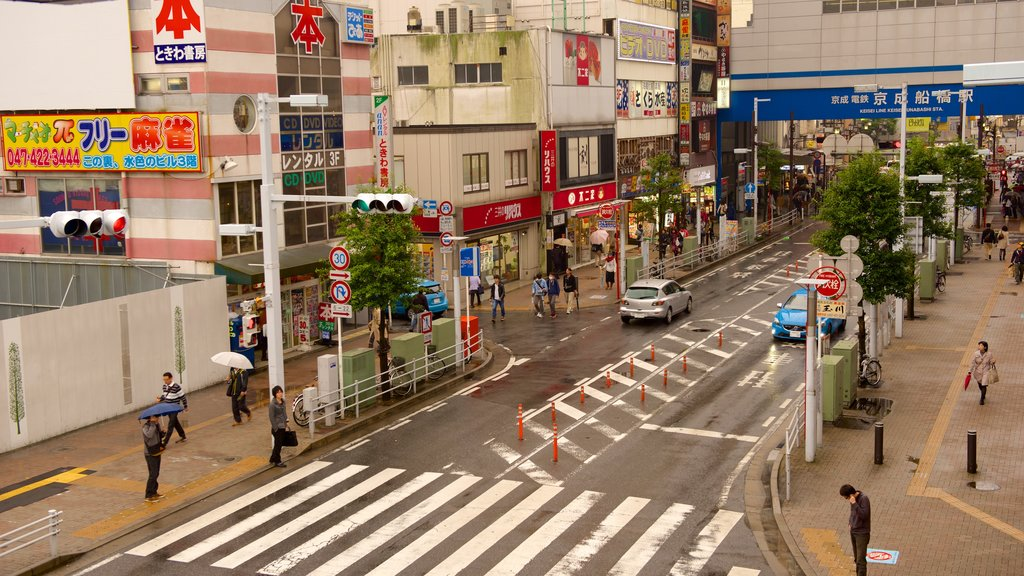 Funabashi which includes street scenes