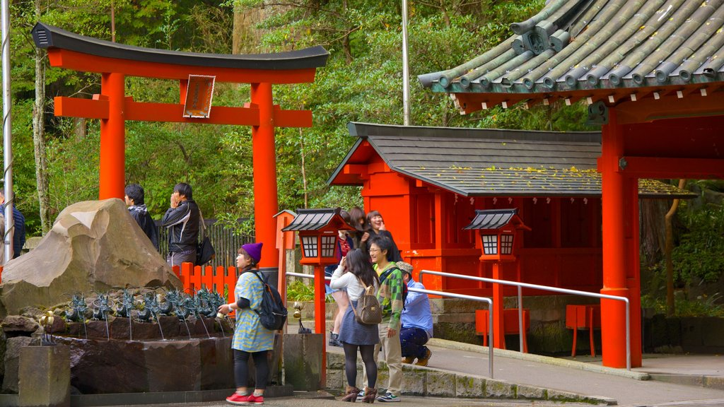 Hakone Shrine which includes a temple or place of worship as well as a small group of people