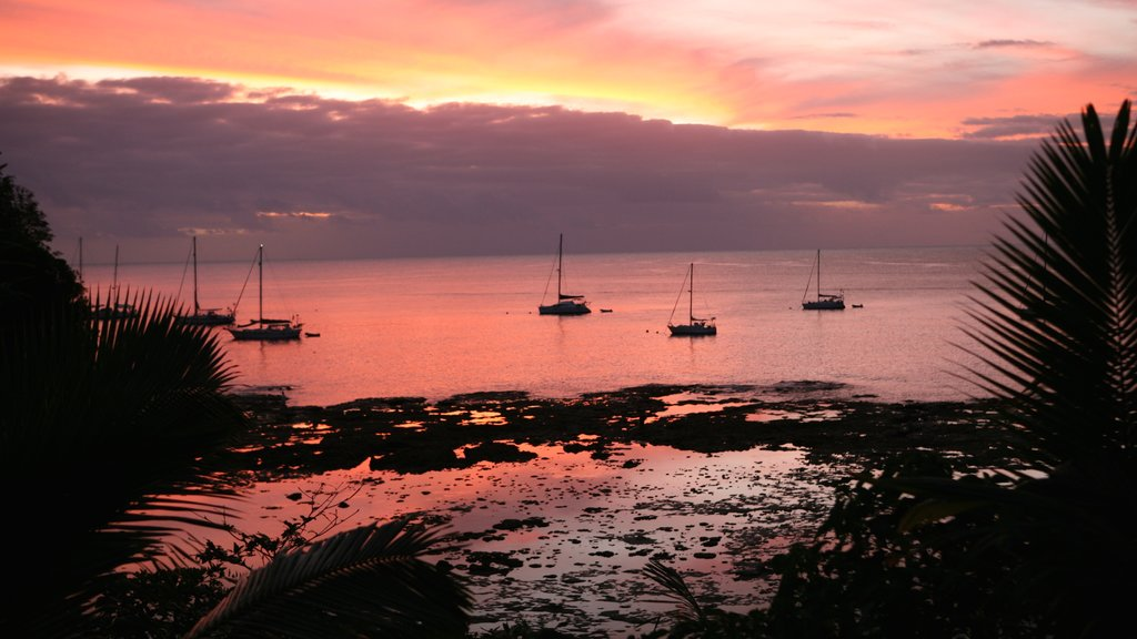 Niue which includes sailing, a sunset and general coastal views